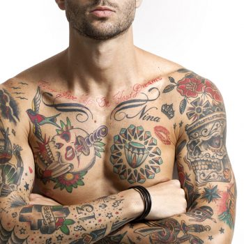 Handsome and sexy tattooed man portrait with crossed arms letterbox